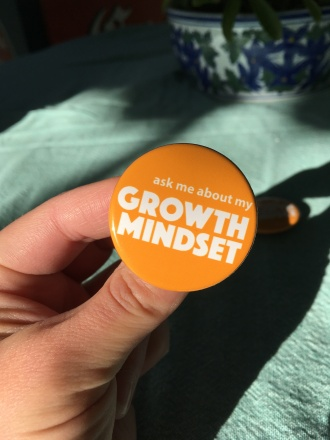 "A wearable conversation starter ""ask me about my Growth Mindset"""